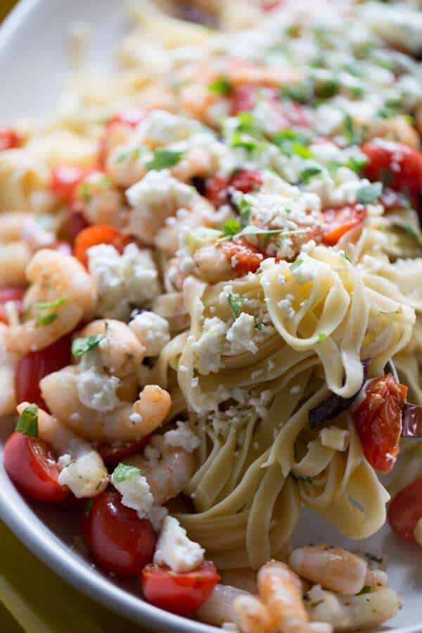 Shrimp, lots of fresh tomatoes, kalamata olives and feta cheese make the easy shrimp scampi recipe a family friendly meal for any night of the week. lemonsforlul.com