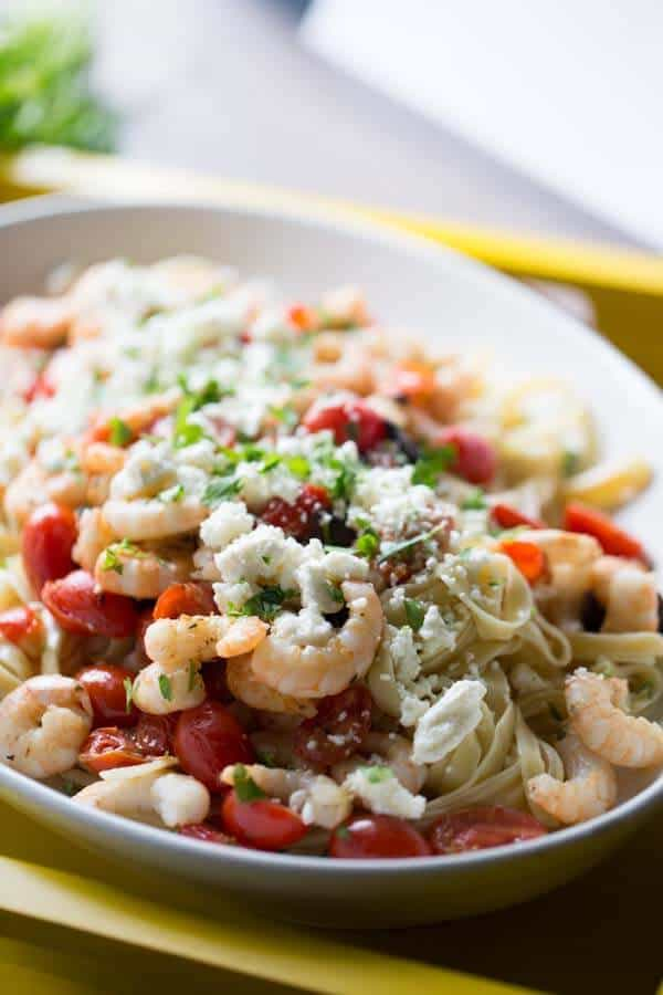 Shrimp scampi with lots of Mediterranean flair with tomatoes, olives and feta cheese. lemonsforlulu.com