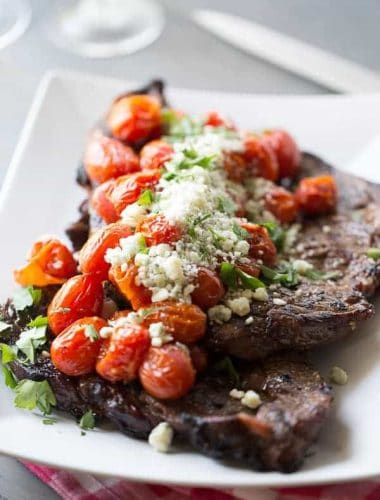 Simple grilled steak with roasted tomatoes and blue cheese. lemonsforlulu.com