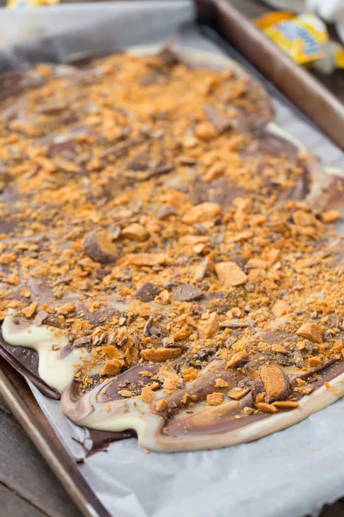 Peanut butter is swirled into chocolate and topped with chopped Butterfinger candies! So simple but so good!