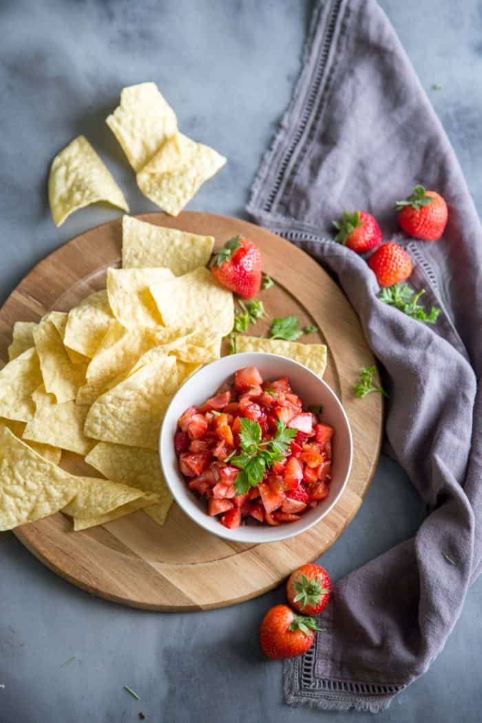 strawberry salsa with chips and berries on the side