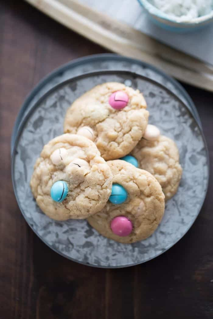 A soft coconut cookie recipe loaded with candy pieces. Each bite is buttery, sweet and delicious!