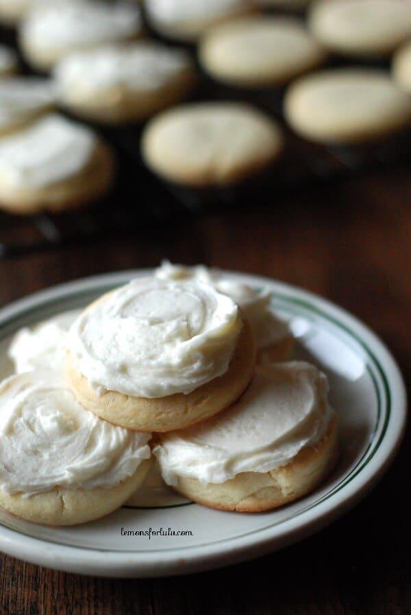 Eggnog sugar cookies are cake-like sugar cookies, iced with spiced eggnog buttercream! | www.lemonsforlulu.com