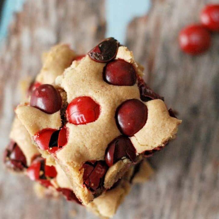 Brown sugar blondie brownies loaded with cherry M & M's! www.lemonsforlulu.com