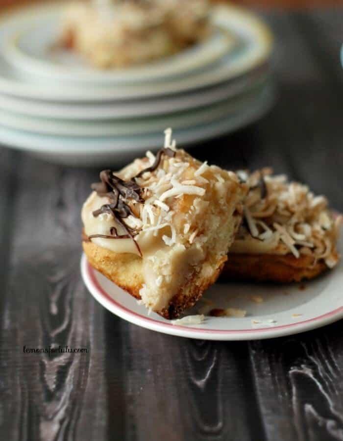Samoa cinnamon rolls with a caramel frosting, toasted coconut and chocolate. www.lemonsforlulu.com