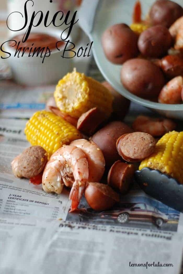 Jumbo shrimp, red potatoes, corn sausage and lots of spice piled high for a good old shrimp boil! www.lemonsforlulu.com