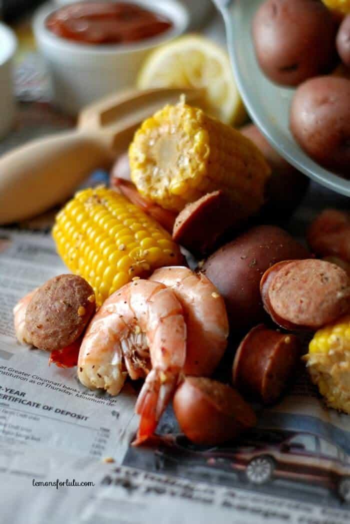 Shrimp, spices, potatoes, sausage and corn! Finger food at it's best! www.lemonsforlulu.com