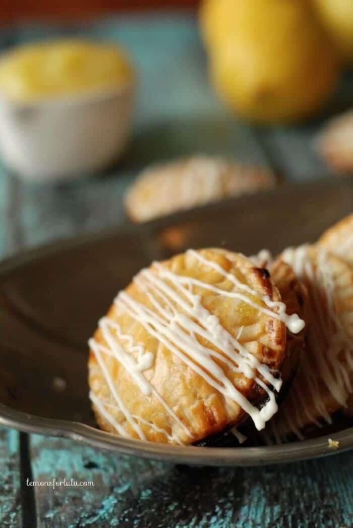 Mini Lemon Hand Pies with white chocolate drizzle