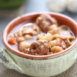An easy vegetable soup with pasta and homemade meatballs that will have your family asking for seconds! lemonsforlulu.com