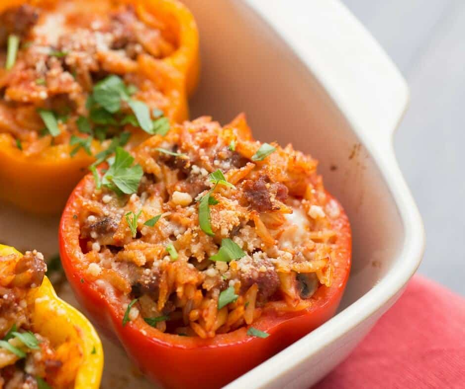 Italian stuffed peppers have ingredients you love like Italian sausage, orzo mushrooms and of course, cheese!