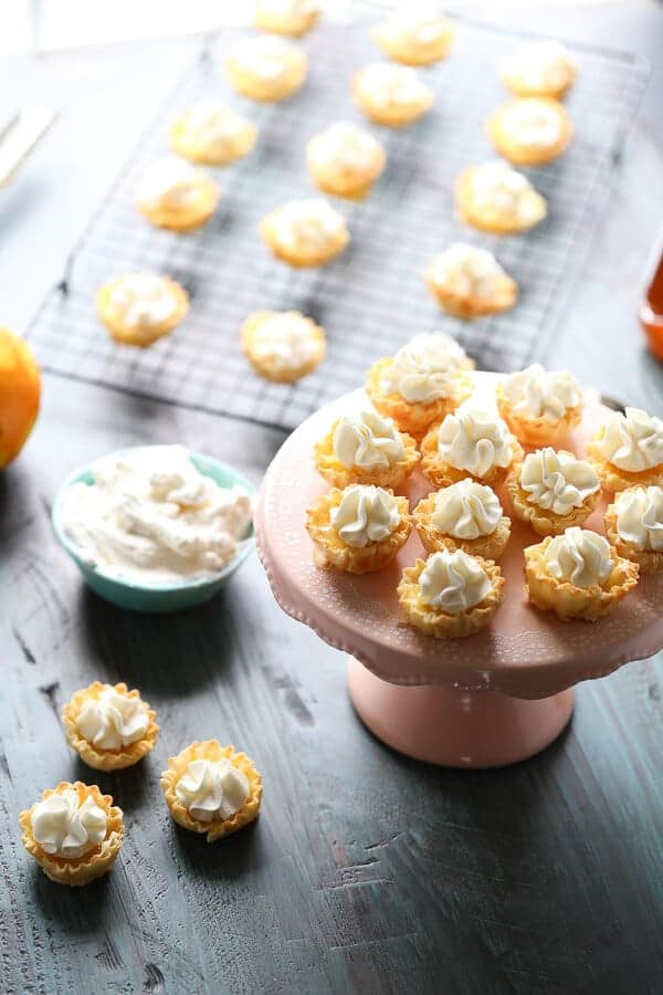 These mini orange tarts with honeyed whipped cream is the perfect ending to any meal! lemonsforlulu.com