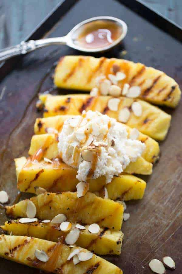 Easy Grilled Pineapple is sweet and delicious! Serve it with a simple mascarpone whipped cream! lemonsforlulu.com