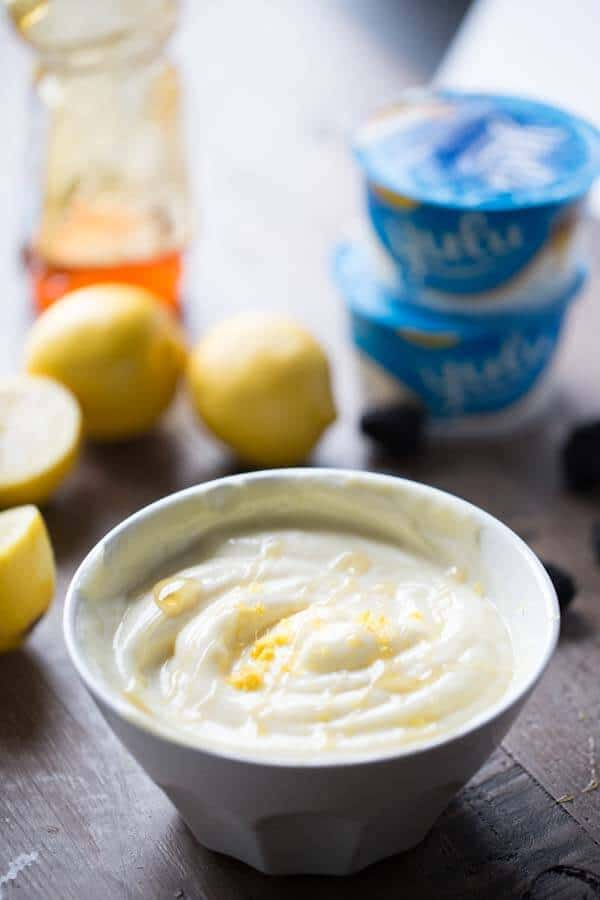 An easy fruit dip with a mix of honey flavored yogurt, fresh lemon curd and a drizzle of honey! lemonsforlulu.com #AussieStyle #Ad