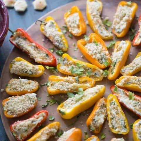 Mini stuffed peppers are grilled just until soft and the two kinds of cheese stuffed inisde begin to bubble! Each pepper is loaded with kale, cheese and bacon! lemonsforlulu.com #ChoppedAtHome