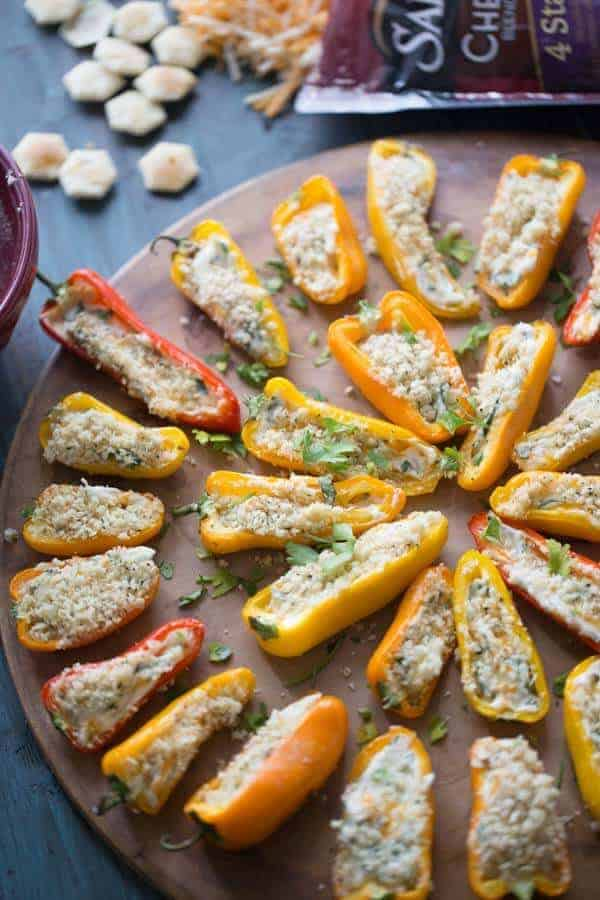 Mini stuffed peppers are grilled just until soft and the two kinds of cheese stuffed inisde begin to bubble! Each pepper is loaded with kale, cheese and bacon! lemonsforlulu.com #ChoppedAtHome #ad