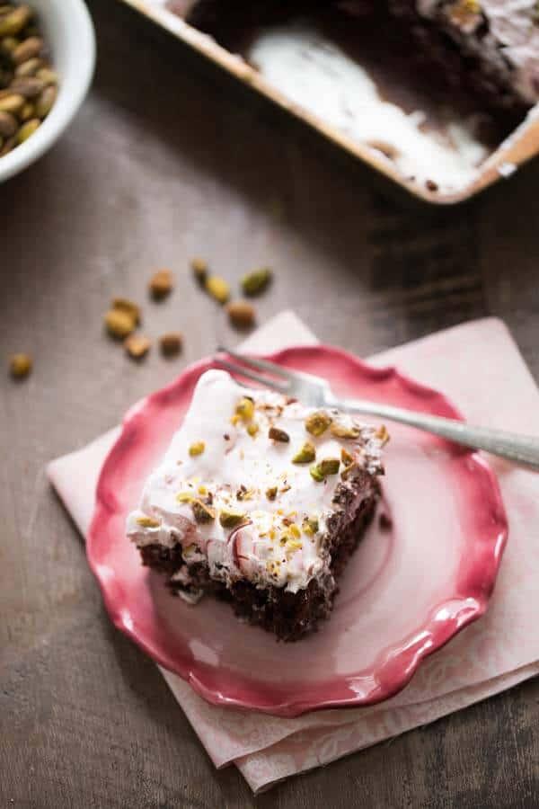 This delicious chocolate poke cake recipe takes it's inspiration from a classic Italian dessert! lemonsforlulu.com