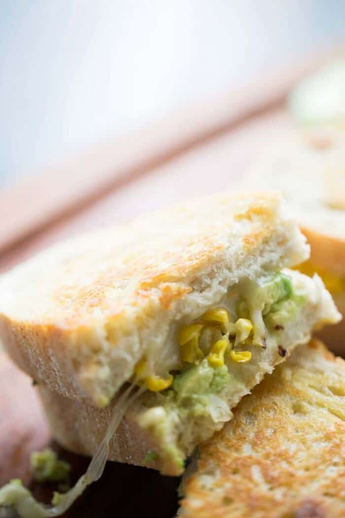 This grilled cheese avocado sandwich is loaded with smokey grilled corn and spicy pepperjack cheese! lemonsforlulu.com