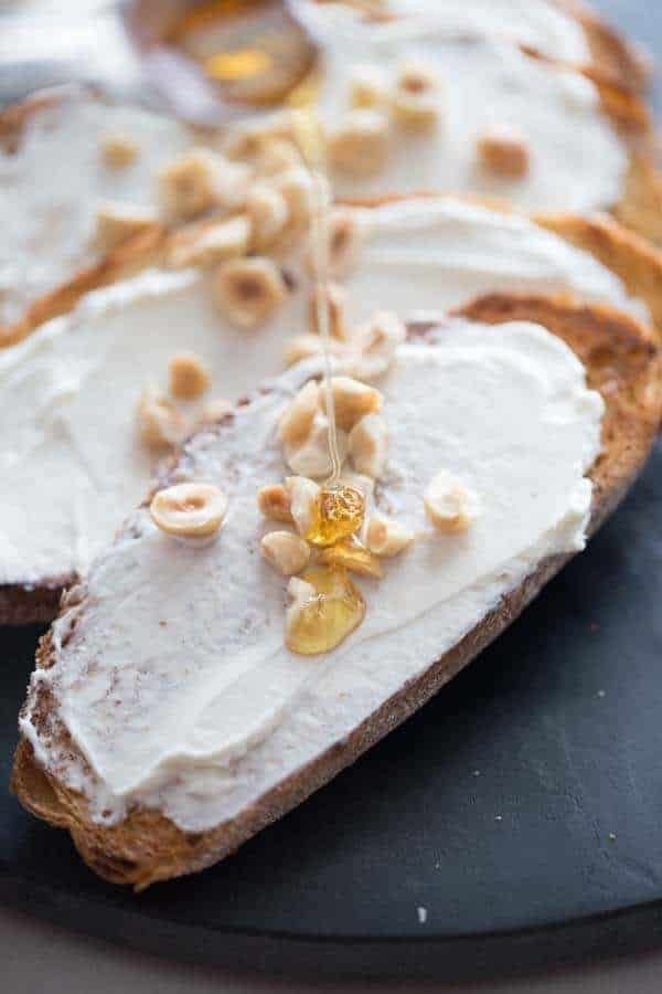 This simple elegant goat cheese appetizer is rich, tangy, sweet and delicious! The crunchy hazelnuts takes it to a whole new level! lemonsforlulu.com