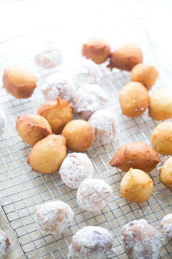 Ricotta doughnuts are just lightly fried then covered in pillowy powdered sugar. Each little ball is served with raspberry sauce and caramel sauce; each bite literally melts in your mouth! lemonsforlulu.com
