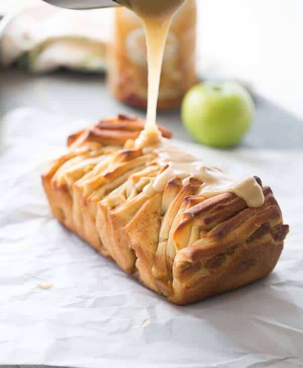 Sweet pull-apart bread filled with apples and cinnamon and covered in a sweet caramel glaze! lemonsforlulu.com #CreateDelight #IDelight