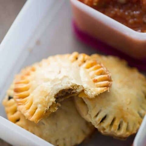 These little meat hand pies taste like tacos with a flakey, buttery crust! lemonsforlulu.com