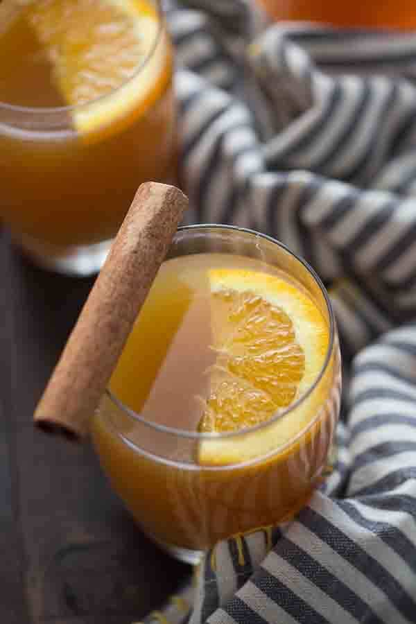 Sweet apple cider is heated and combine with bourbon, fresh orange juice and a touch of sugar. This is the perfect way to warm up on those chilly fall evenings. lemonsforlulu.com