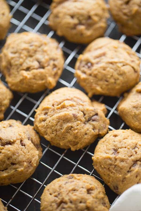 Soft pumpkin filled cookies stuffed with lots of toffee bits! The perfect fall inspired cookie! lemonsforlulu.com
