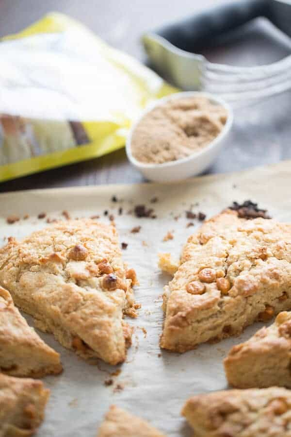 Maple scones studded with butterscotch chips and drizzled with a simple maple glaze! lemonsforlulu.com