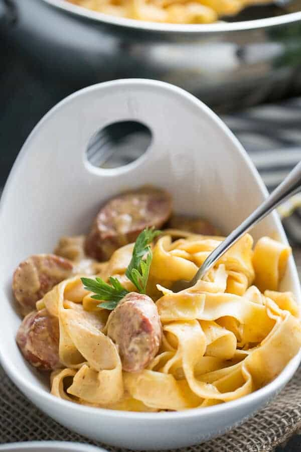 A spiced up pumpkin pasta recipe with smoked sausage and chipotle peppers! lemonsforlulu.com