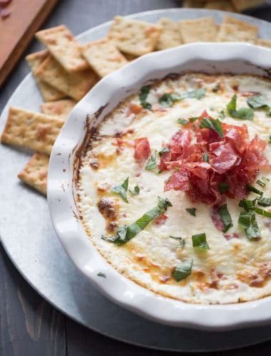 A new kind of bruschetta dip! This dip is full of hot melted cheese but tomatoes add a fresh spin while peppery soppressata add a unique to taste! lemonsforlulu.com