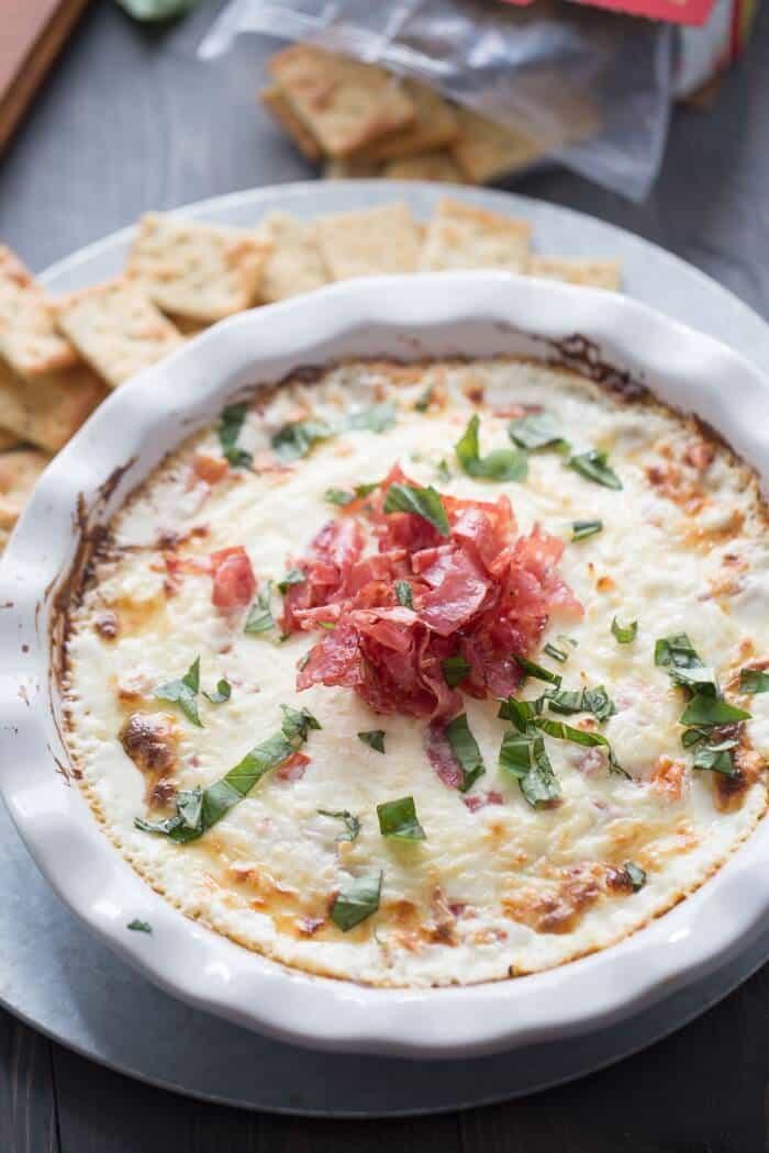 Hot bruschetta dip with cheese, tomatoes and soppressata! lemonsforlulu.com