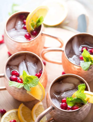 And easy Moscow Mule recipe with cranberry juice, ginger beer and a hint of citrus! lemonsforlulu.com