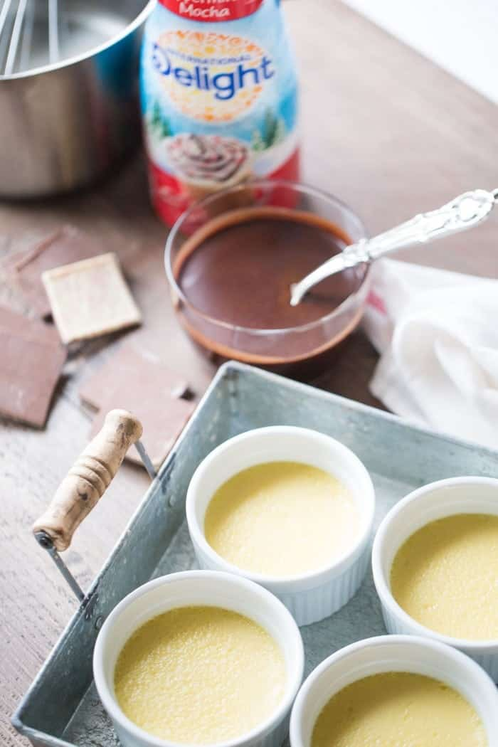 Pots de creme with a white chocolate custard that is topped with a chocolate ganache! So good and so simple! lemonsforlulu.com