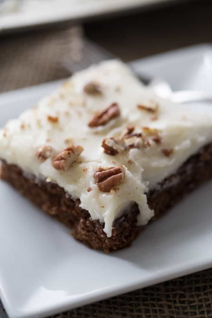 A twist on a classic Texas sheet cake recipe; this chocolate cake has a hint of gingerbread and a creamy vanilla frosting lemonsforlulu.com