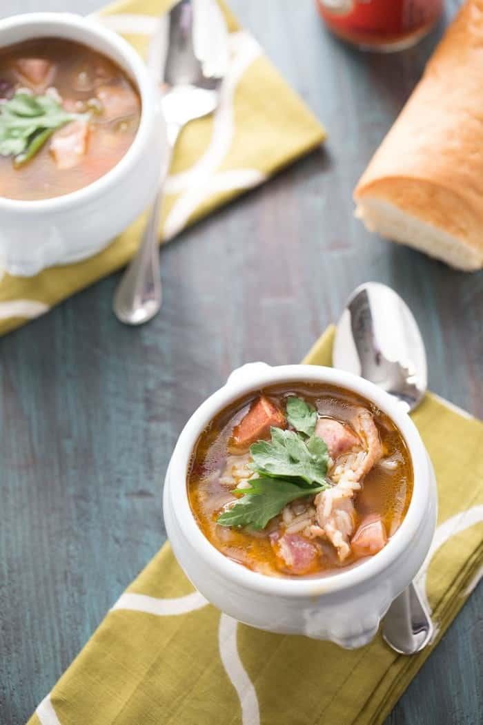 This warm weather soup is filled with beans and rice, bacon and sausage! What could be better? lemonsforlulu.com