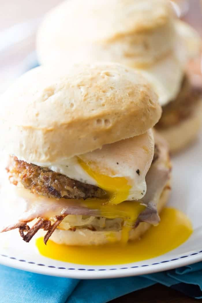 A breakfast egg sandwich that will keep you full! This loaded sandwich has biscuits stuffed with hash browns, cheese, Goetta and eggs!