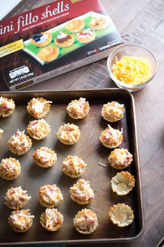 This appetizer starts with fillo shells that are filled with an easy pimento cheese recipe then baked until hot and bubbly! These little bites are irresistible!