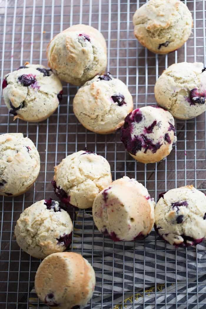 Blueberry Muffin are speckled with poppy seeds and topped with a tangy lemon glaze!