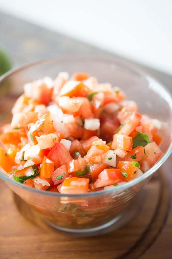 Bloody Mary salsa has no alchohol, but it does have lots of flavor! Fresh tomatoes, onions and seasoning make this salsa irresistible!
