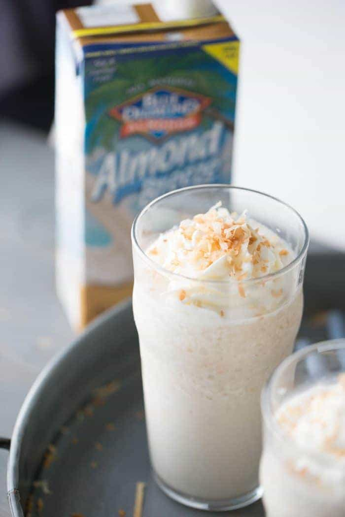 This frozen white hot chocolate combines to greats; white chocolate and toasted coconut! This cold beverage is a real sweet and creamy treat!