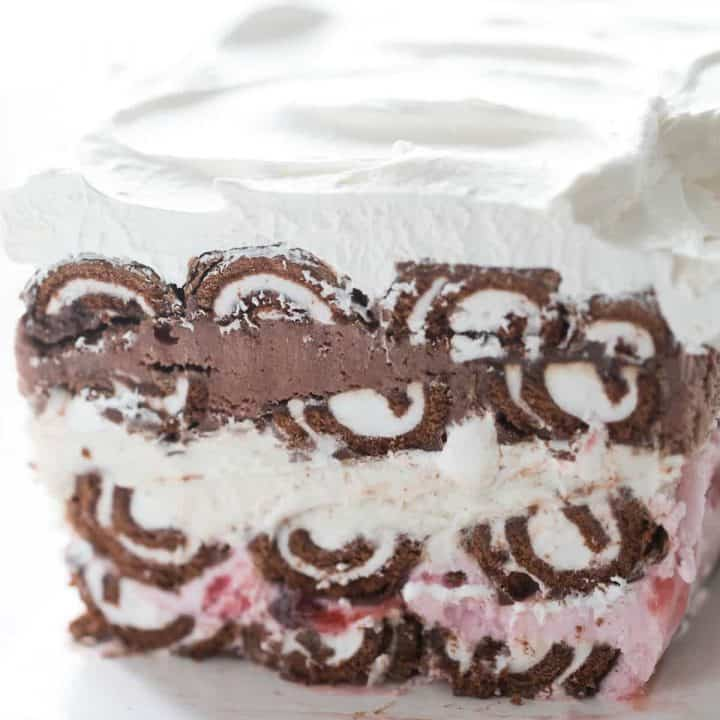 A Swiss Roll ice cream cake with so many lovely layers! Swiss Roll cakes are separated by layers of strawberry ice cream, vanilla ice cream and chocolate ice cream!