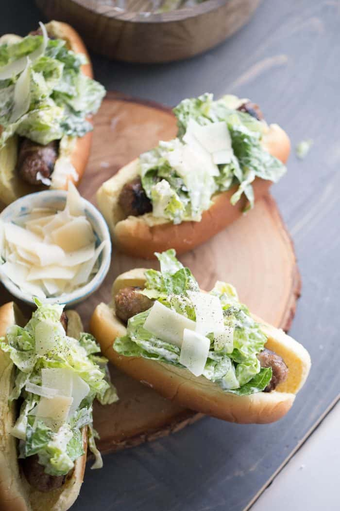 Caesar Salad is cool, crisp and creamy. This easy salad is the perfect counterpart to hot, grilled sausage!