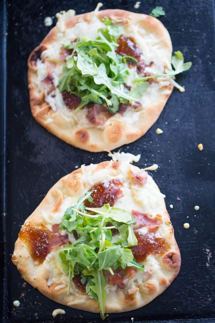 Naan Pizza is made by topping naan bread with creamy fontina cheese, salty prosciutto and sweet fig jam. The combination is sensational! | Recipe on lemonsforlulu.com