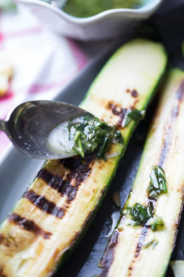 Grilled zucchini spear with fresh herbs
