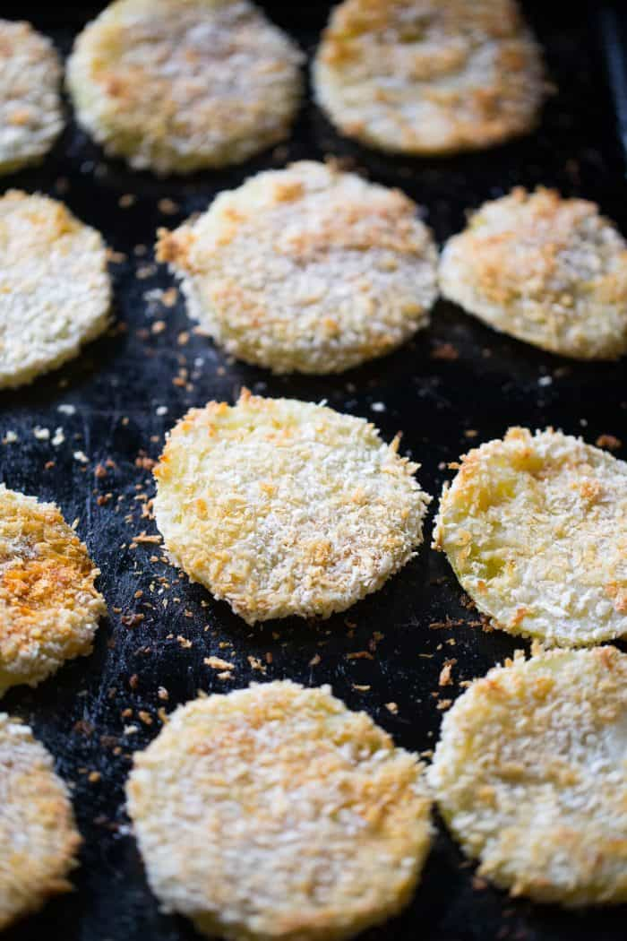 fried green tomatoes on a baking sheet