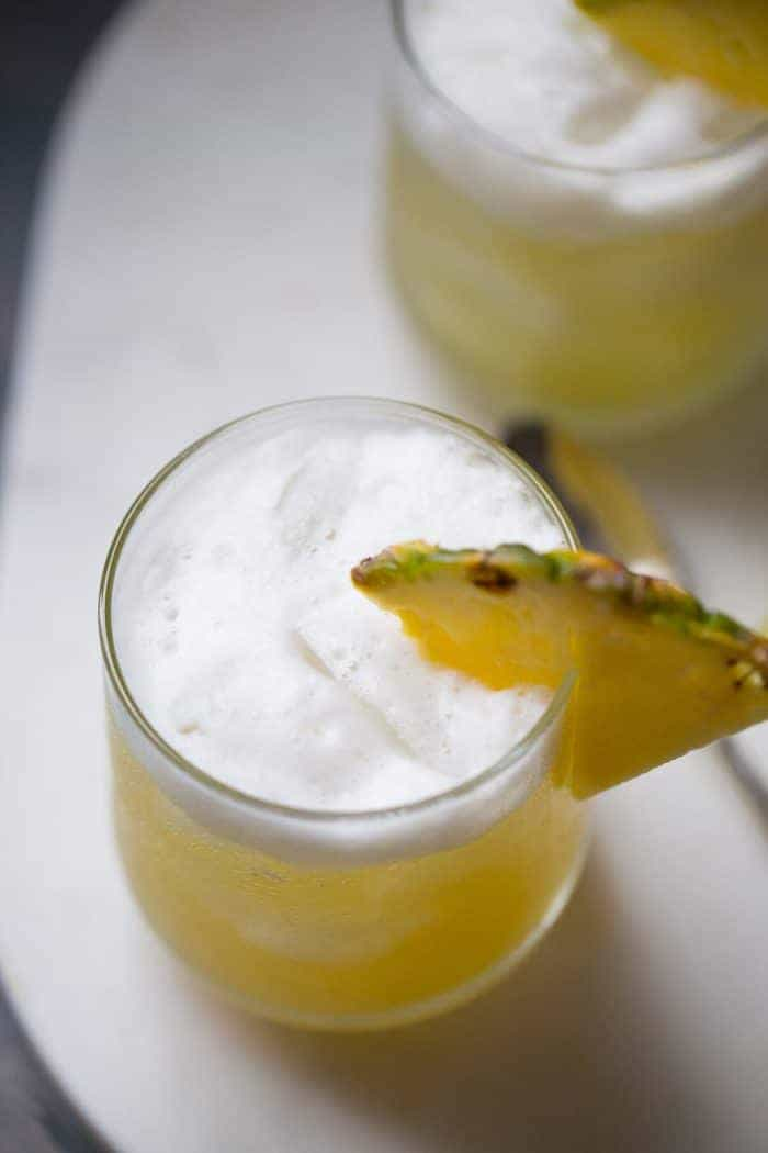 Pineapple Bourbon Punch - Nutty hazelnut flavor and pineapple are infused into bourbon to make this delicious cocktail recipe!   lemonsforlulu.com