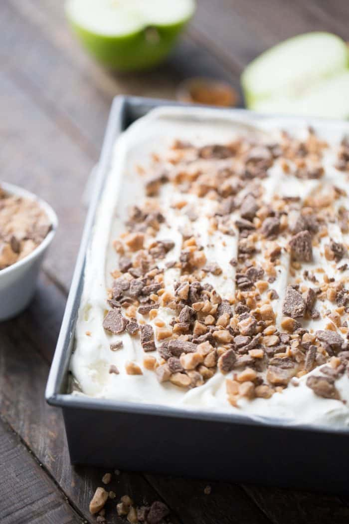 """This eclair cake is like apple pie but better! Graham crackers are the """"cake"""" layers that are held in place with apple pie filling and apple spiced pudding. Toffee bits crown the top!"""