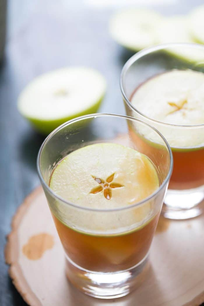 Caramel apple cocktail is the adult version of the classic fall treat! Crisp rum, apple and caramel liqueurs make this the perfect beverage for fall!