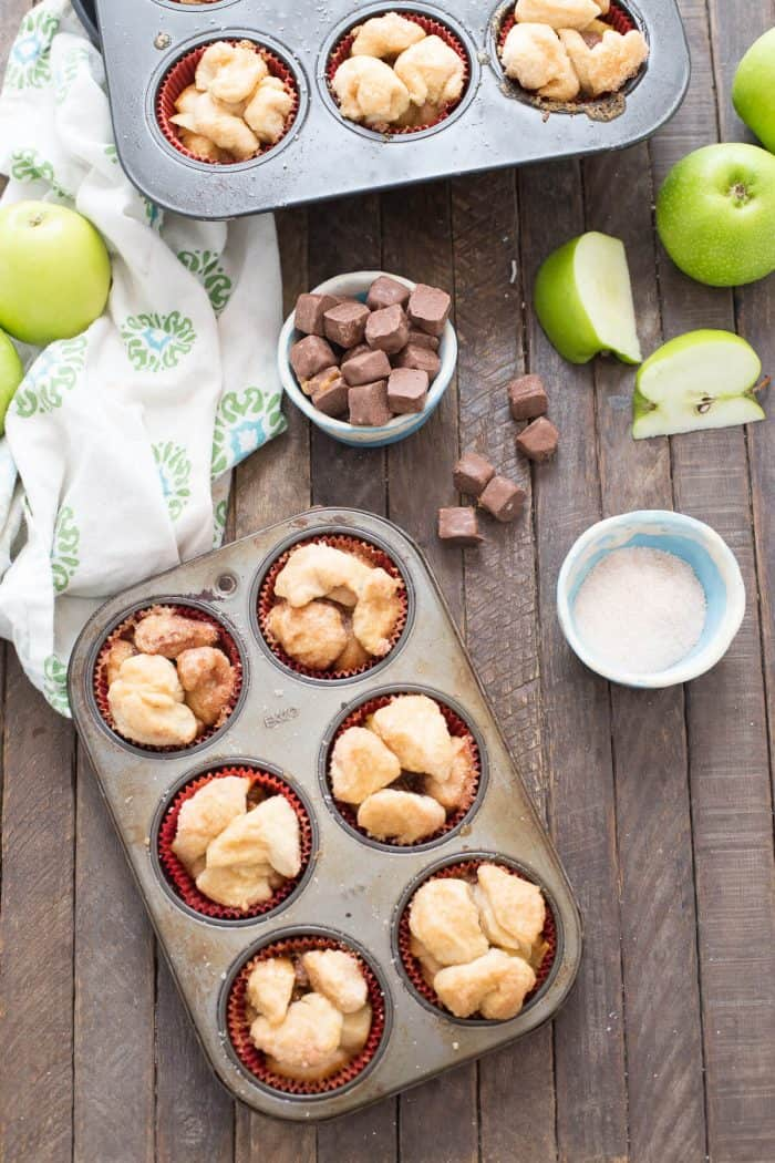 Love monkey bread? These little muffins are even better! Caramel and apples are tucked inside each one!