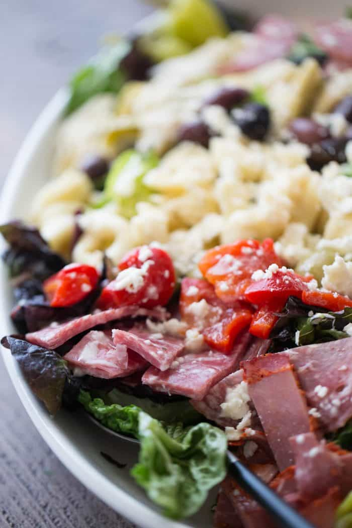This Italian chopped salad is bursting at the seams! It is loaded with meats, cheese, veggies and pasta and boasts a creamy Italian dressing!